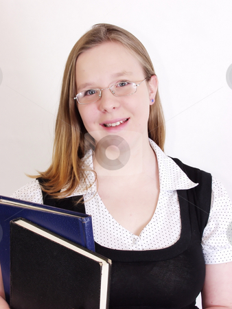 Studious stock photo, A young school girl holds her books and smiles. On a solid white background. by Robert Gebbie