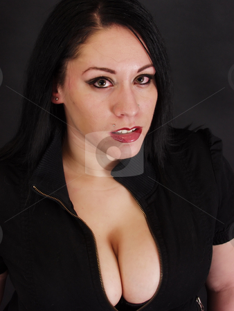 Captivating Goth stock photo, A beautiful fair skinned woman with dramatic eyes and ruby red lips against a black background. by Robert Gebbie