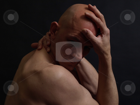 In the Dark stock photo, A nude bald male in the shadows over a black background. by Robert Gebbie