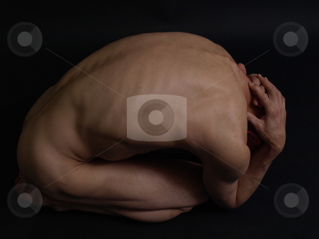 Gone stock photo, A nude male curled up into a ball on a black background. by Robert Gebbie