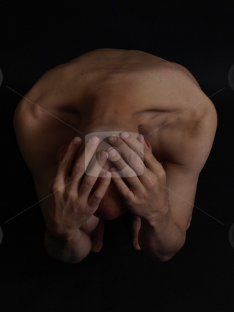 Can't Take It stock photo, A nude male cowers, his head covered with his hands, over a black background. by Robert Gebbie