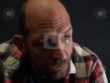 Goodbye stock photo, A middle aged balding man sheds a sad tear of farewell. by Robert Gebbie