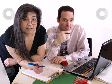 Your Business Team stock photo, A male and female working together in the office at the computer. Isolated against a white background. by Robert Gebbie