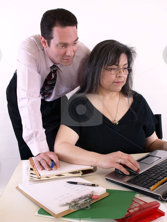 Teamwork stock photo, A male and female working together in the office at the computer. Isolated against a white background. by Robert Gebbie
