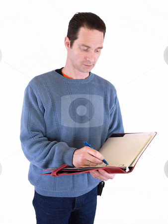 Writing it Down stock photo, An adult male taking notes in a binder, isolated against a white background. by Robert Gebbie