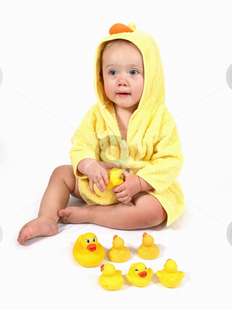 Just Another Yellow Duckie stock photo, A female child wearing a yellow bathrobe plays with her rubber ducks. by Robert Gebbie
