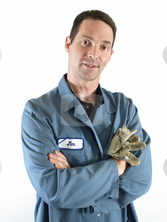Man in Blue Smock stock photo, A male employee in a blue lab coat stands with his arms crossed. by Robert Gebbie