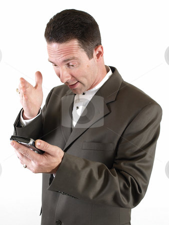 How Did This Happen? stock photo, A man gestures in disbelief as he looks at the screen on his pda. by Robert Gebbie