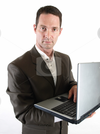 Man with Laptop stock photo, A business man makes an entry on his personal computer. by Robert Gebbie