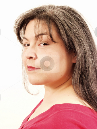 Woman stock photo, A woman with greying hair takes a sly look at the camera. On an isolated white background. by Robert Gebbie