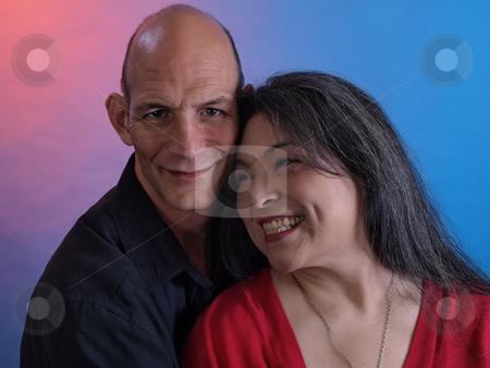 Happy Couple stock photo, A middle aged couple smile happily together. by Robert Gebbie