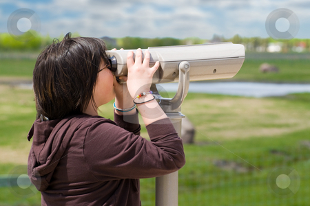 Viewpoint Coin Binoculars stock photo, A young girl looking through a set of viewpoint binoculars over prairie landscape by Richard Nelson