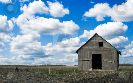 Abandoned Farm House stock photo, An old wooden farm house abandoned a long time ago, sitting under a blue partly cloudy sky by Richard Nelson