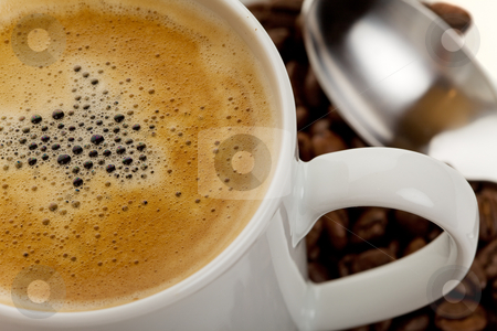 Morning coffee stock photo, Close up of a cup of hot coffee with beans and spoon in background by Steve Mcsweeny