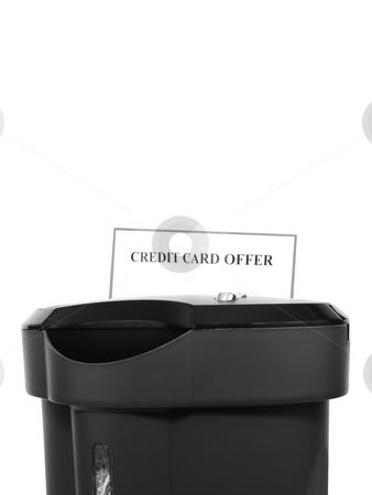 Paper shredder with Credit card offer stock photo, Paper shredder destroying credit card offer by John Teeter