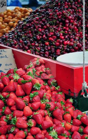 Mixed fruits at street market stock photo, Strawberries, cherries, oranges. Mixed fruits at street market by Fernando Barozza