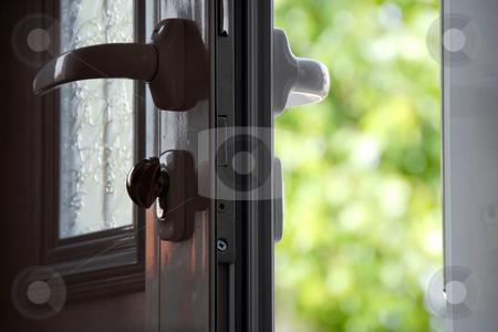 Opened door stock photo, Opened door to blur green natural background by Julija Sapic
