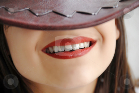 Young girl smile stock photo, Young girl beautiful lips smiling under brown hat by Julija Sapic