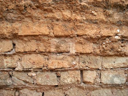 Wall stock photo, Orange and irregular wall made with rectangular bricks by Marc Torrell