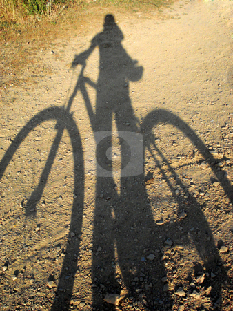 Shadow stock photo, Shadow of mountain bike on sand. by Marc Torrell