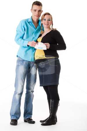 Pregnant couple with a babycap stock photo, Young lovely caucasian couple expecting their baby by Frenk and Danielle Kaufmann