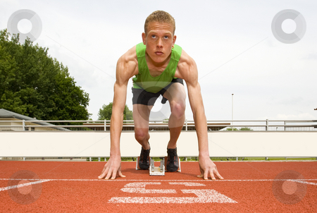 Set to start stock photo, Athlete in lane five, set to start in the starting blocks for a sprint run by Corepics VOF