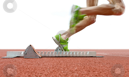 Starting blocks stock photo, Action packed image of an athlete leaving the starting blocks for a sprint run on a track by Corepics VOF