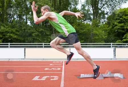 Explosive start stock photo, Explosive start of an Athlete leaving the starting blocks on a sprint run by Corepics VOF