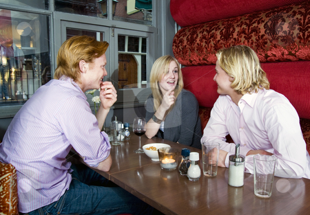 Cafe talk stock photo, Three people chatting in a cafe by Corepics VOF