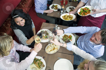 Restaurant dinner stock photo, A group of friends having dinner at a restaurant by Corepics VOF