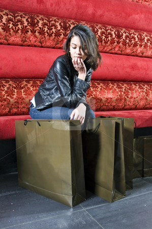 Young adult resting after shopping stock photo, A young woman taking a rest in a restaurant after shopping by Corepics VOF