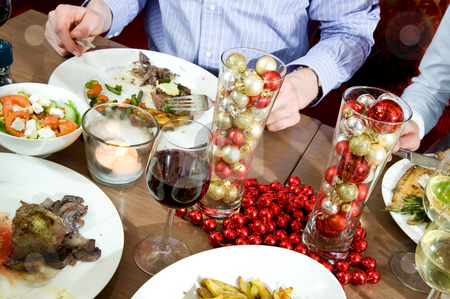 Christmas dinner stock photo, Dishes on a restaurant table, decorated for christmas by Corepics VOF