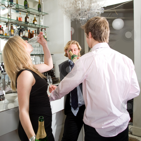 Drunks drinking champagne stock photo, Three drunken persons drinking and talking at a bar by Corepics VOF