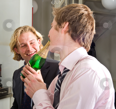 Drunks drinking champagne stock photo, Two young, drunken adults drinking champagne by Corepics VOF