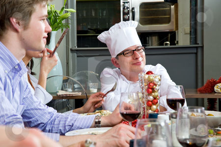Fishing for compliments stock photo, Restaurant chef fishing for compliments with his guests by Corepics VOF