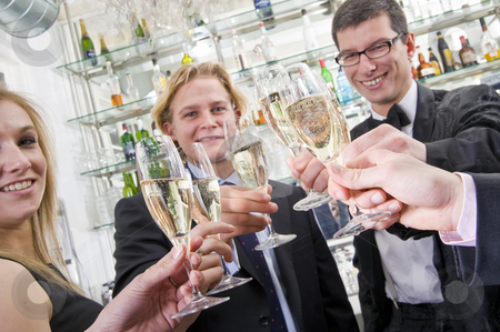 A toast on new years eve stock photo, Several people toasting with champagne while looking in the camera by Corepics VOF