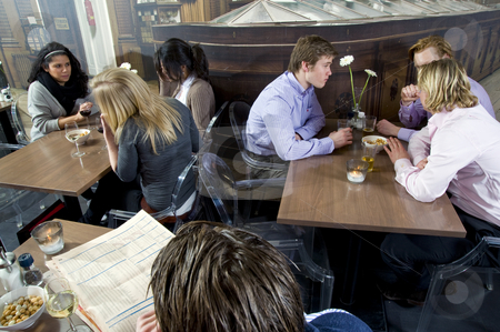 People in a restaurant stock photo, Several customers having a drink in a restaurant by Corepics VOF