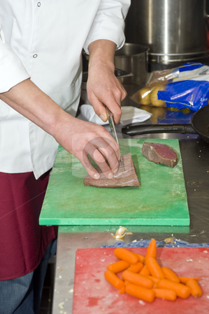 Chef and Sous-chef stock photo, A chef and his sous-chef working in a kitchen by Corepics VOF