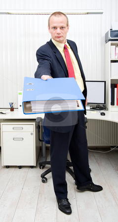 Thick dossier stock photo, Businessman holding a thick dossier in his outstretched arm by Corepics VOF
