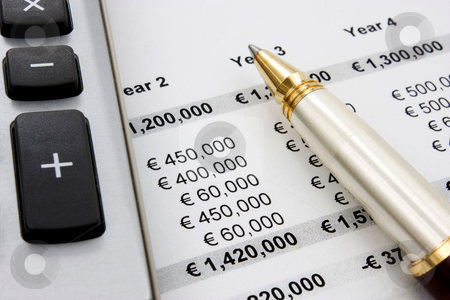 Financial and Sales report stock photo, Financial or sales report with pen and calculator. Close up by Gabriele Mesaglio