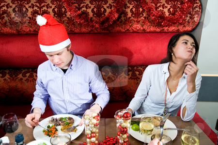 Restaurant Christmas stock photo, Group of friends enjoying their christmas dinner in a restaurant by Corepics VOF