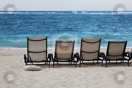 Lounge chairs on beach stock photo, Lounge chairs on beach of Punta Cana, Dominican Republic by Tom P.