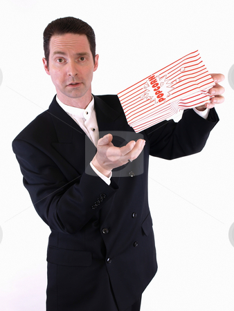 No More Popcorn stock photo, A white male in a suit shakes a bag of popcorn into his empty hand.  He is frustrated because none came out. by Robert Gebbie