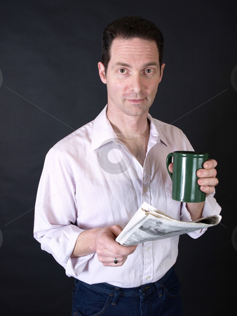 Morning Routine stock photo, An adult man drinking coffee and reading the newspaper. by Robert Gebbie