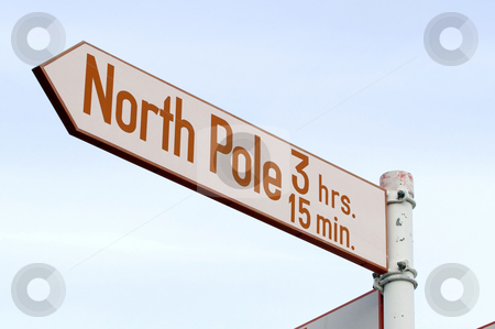 North Pole 3 hrs 15 min stock photo, Road sign to the North Pole! Red and white sign on metal pole by Anders Peter