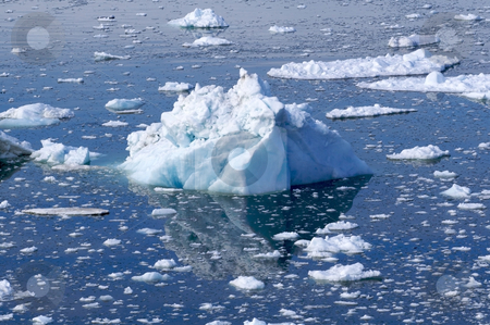 Iceberg #4 stock photo, A small white/blue iceberg lying in the water in Ilulissat, Greenland by Anders Peter