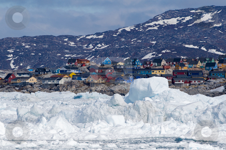 Ilulissat, Greenland, seen from the sea stock photo, The city of Ilulissat, Greenland. The picture i taken from a tour boats going in between the icebergs by Anders Peter