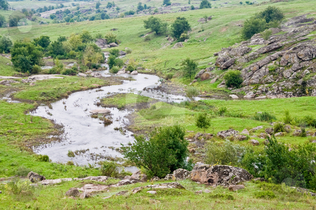 Landscape with stream stock photo, Landscape series: rural view with stone and stream by Gennady Kravetsky