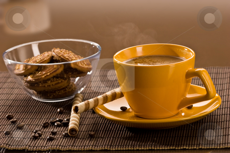 Coffee stock photo, Still life with yellow cup of coffe and pastry by Gennady Kravetsky