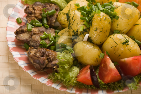 Testy dish stock photo, Cooked potatoes with fried liver decorated spring onion by Gennady Kravetsky